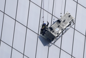 Workers cleaning windows.